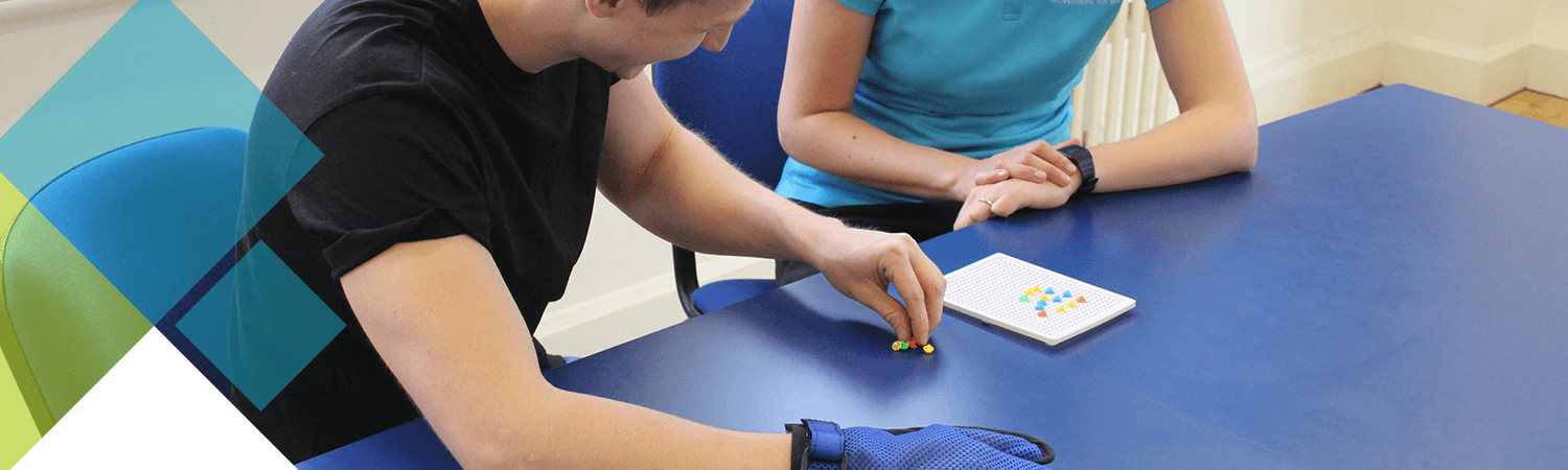 CIMT patient testing out a dexterity challenge