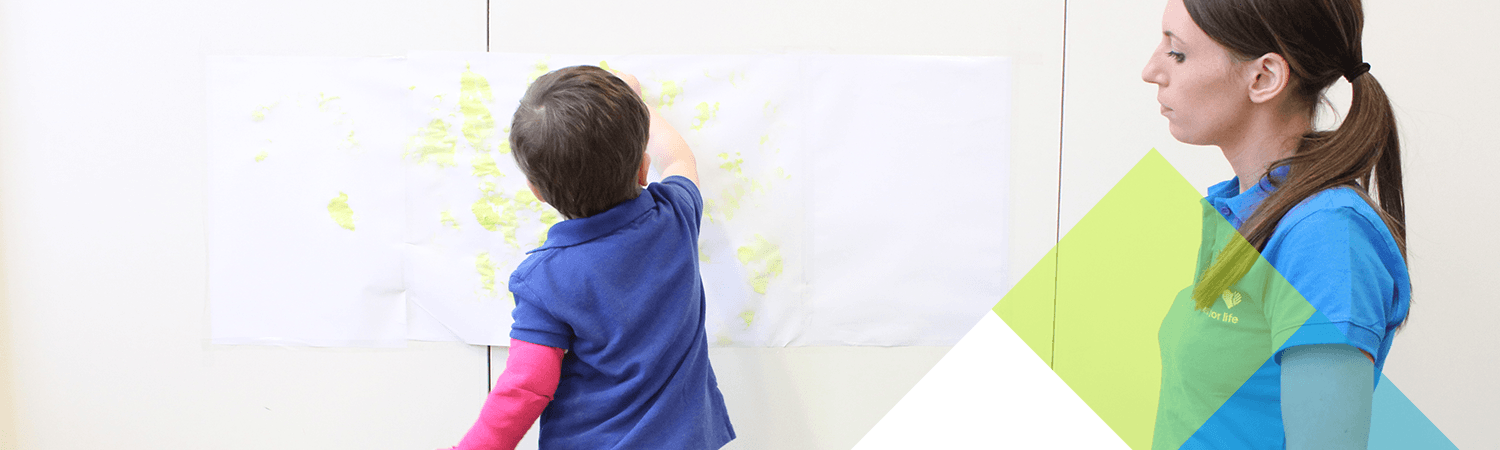 Child draws on paper during initial assessment