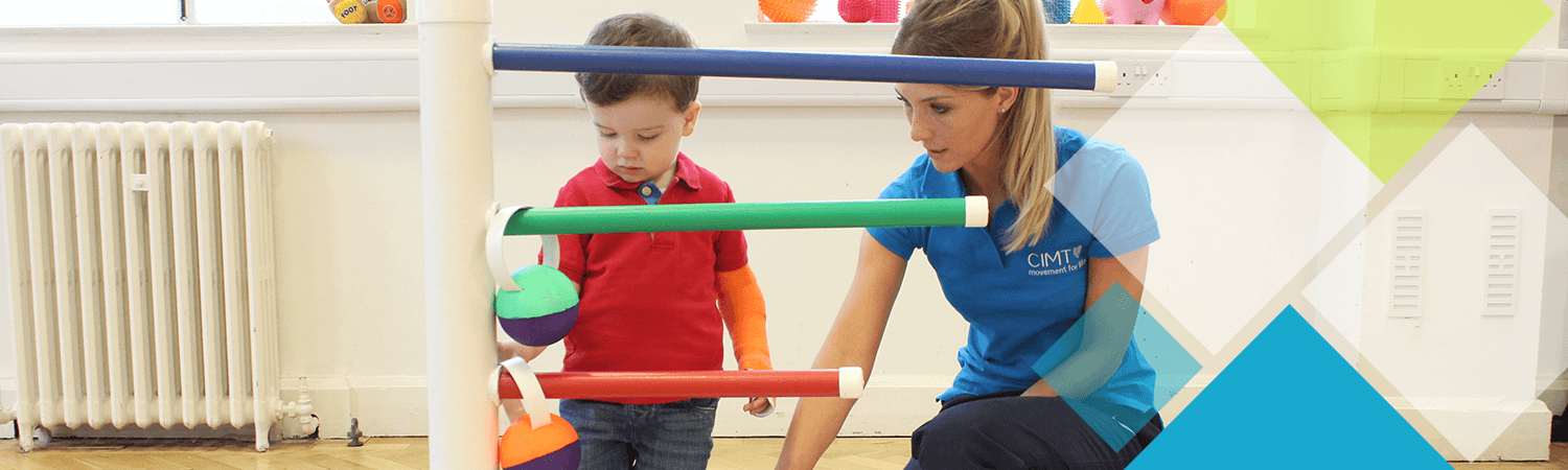 Young child plays during an activity with a CIMT physiotherapist