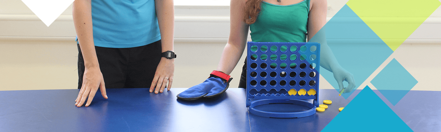 A CIMT patient with their physiotherapist using Connect4 as a tool