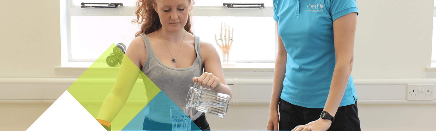 CIMT patient uses jug of water to test an everyday living situation with her constraint mitt