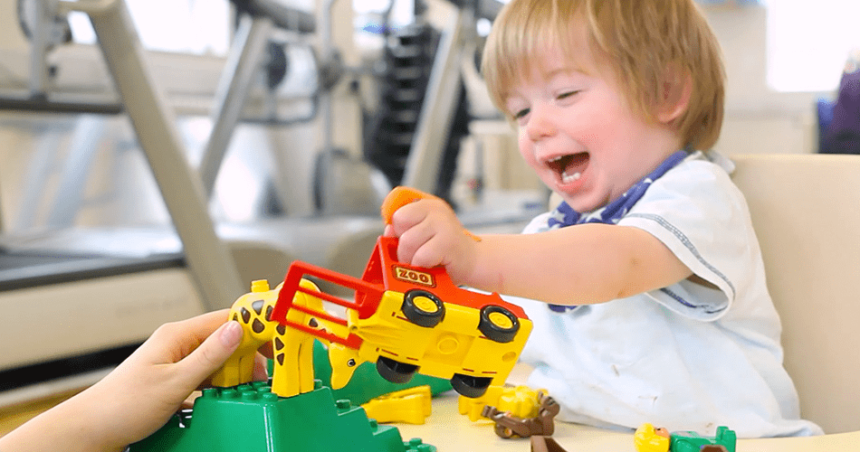 Alistair playing with toy truck during his time with CIMT.